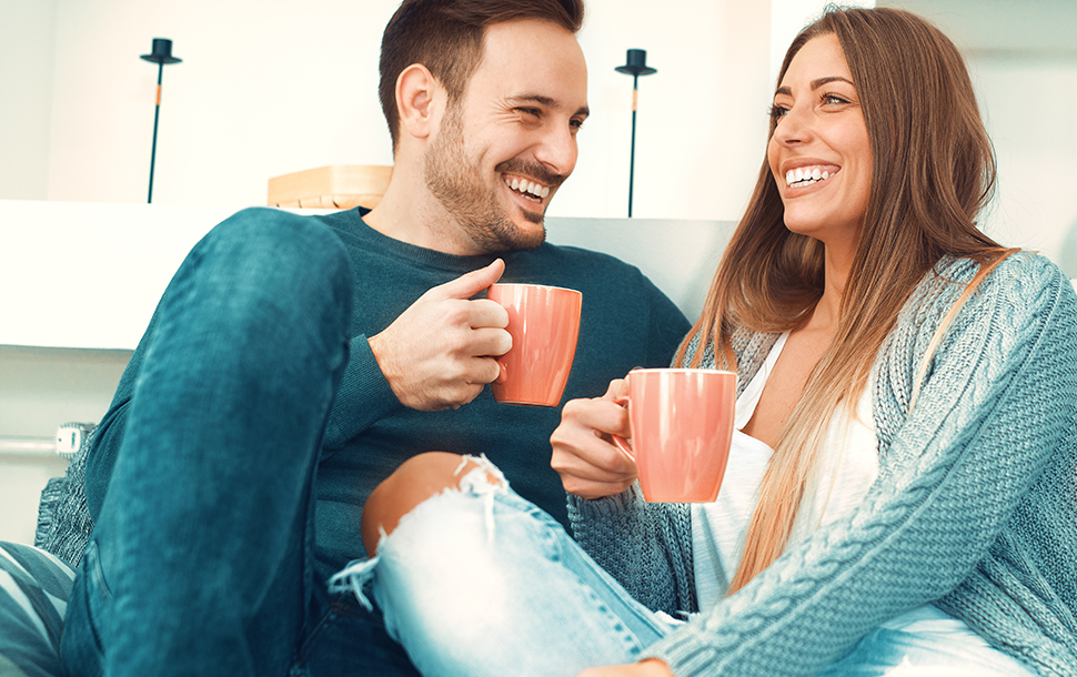Couple having a cup of tea at home