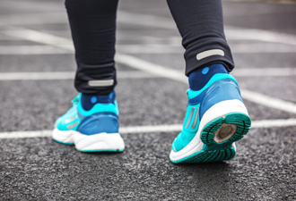 Image: person walking wearing trainers