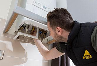 IMAGE: Engineer checking a boiler