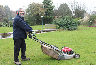 IMAGE: Lee with a lawnmower
