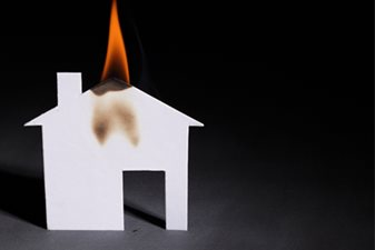 IMAGE: A flame coming from a house