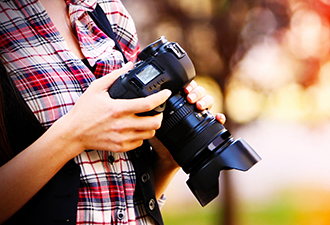 Image: woman holding camera