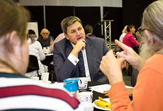 Image: Housing Minister talking to residents