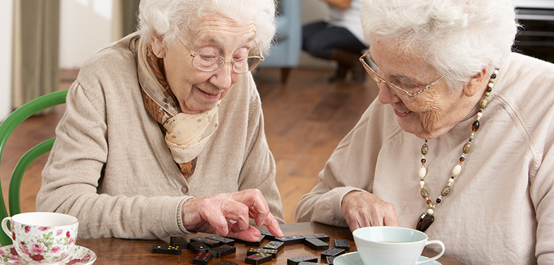 image: Residents playing dominoes at one of our Sheltered schemes