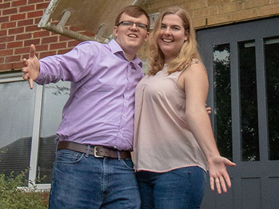 image: Dan and Katie outside their new home