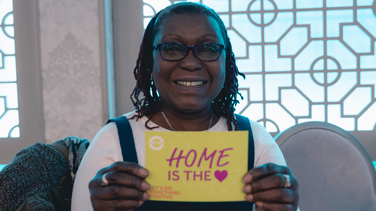 image: a happy resident at our London resident forum