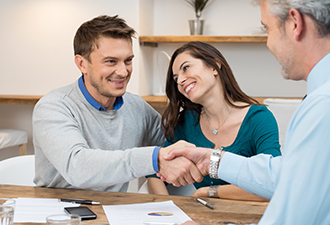 Image: A happy couple talking to someone about borrowing money