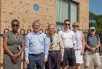 IMAGE: A group outside by the blue plaque