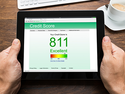 Image: a credit score rating on an iPad