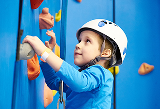 Image: A child using a climbing wall